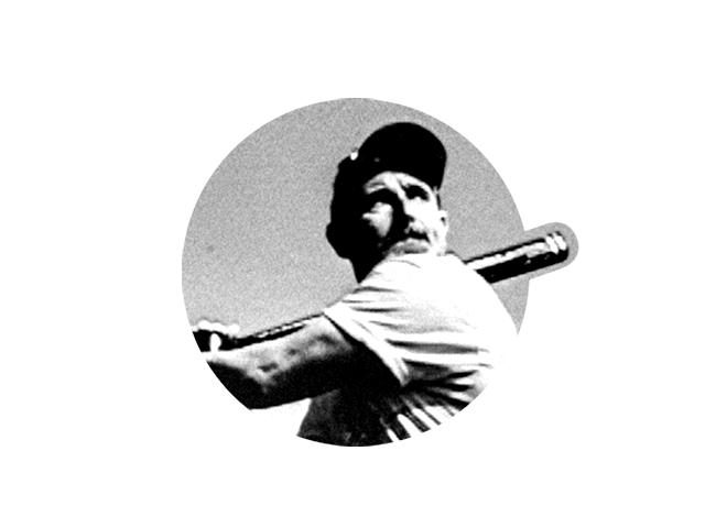 Black and white photo of Ray DeMarini swinging his bat